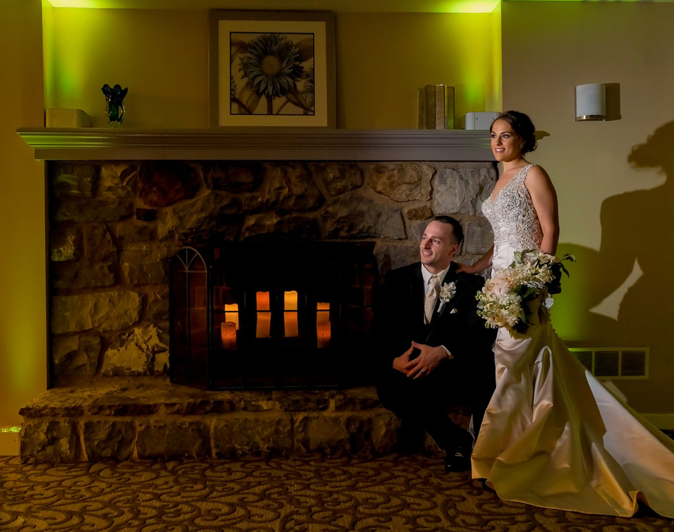 Wedding couple by fire place