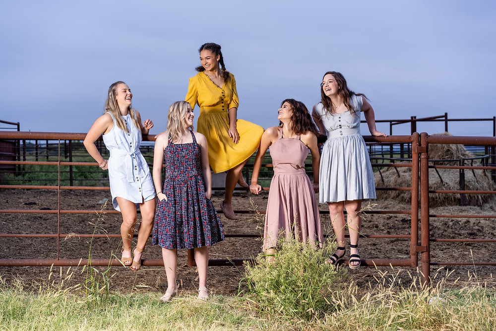 5 high school senior girls modeling clothing from Sevenflock on a farm in Texas