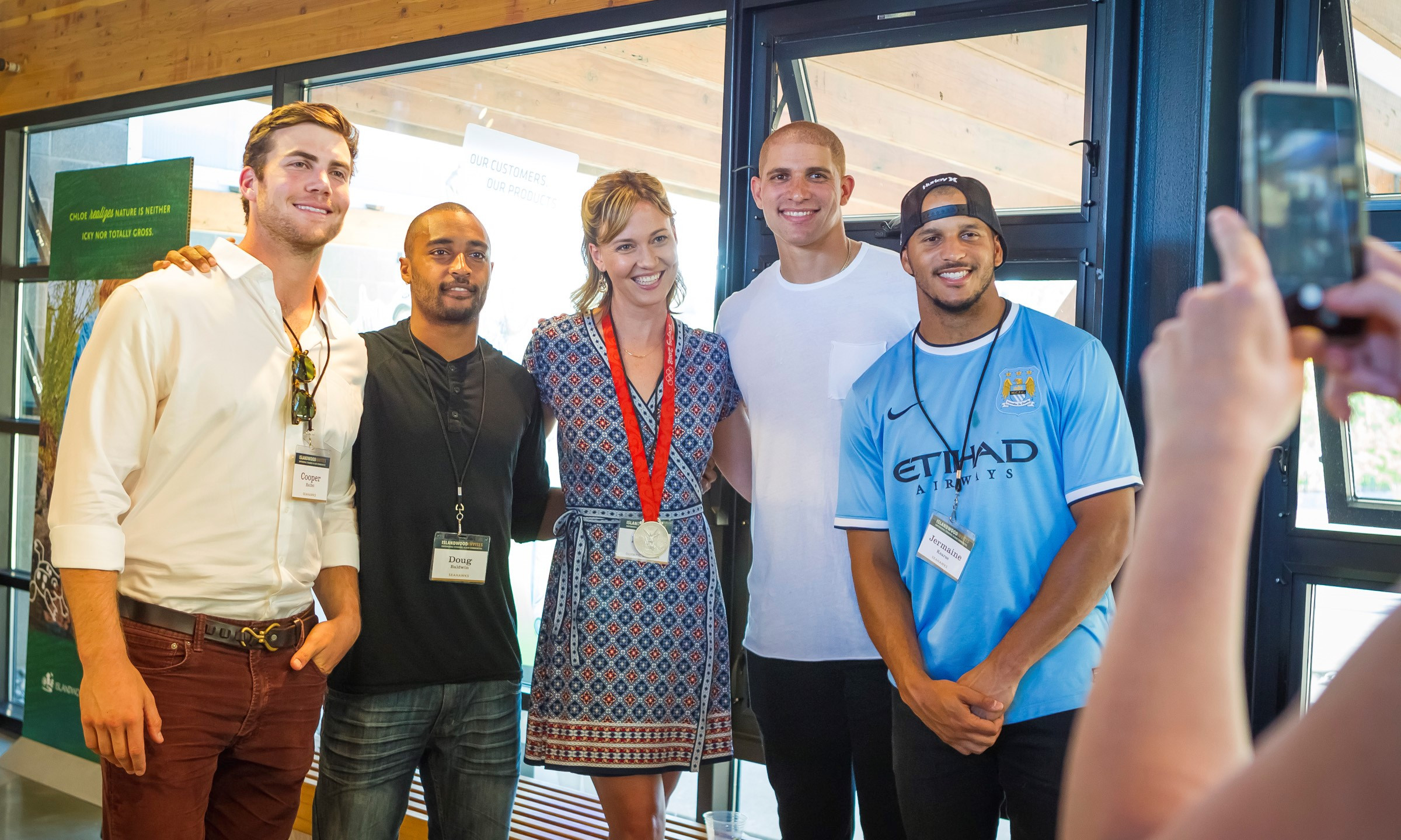 Some of Cooper's teammates came out to support The Nature Project, and as you'd expect, all camera's were pointed there direction. (Left To Right: Cooper Helfet, Doug Baldwin, Emily Silver (2008 U.S. Olympic Silver Medalist), Jimmy Graham, Jermaine Kearse)