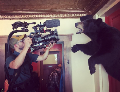 Cinematographer Rod Hassler and a bear.
