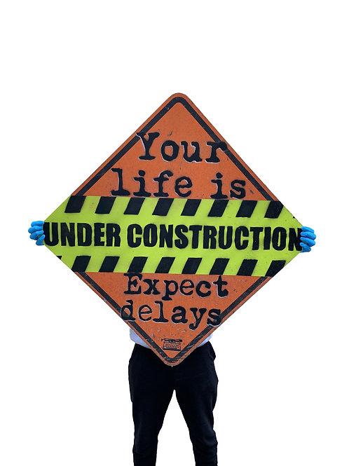 'under construction' on reclaimed street sign (original)
