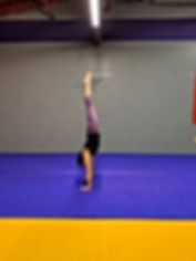 A personal training studentin Syracuse doing a handstand for crossfi training