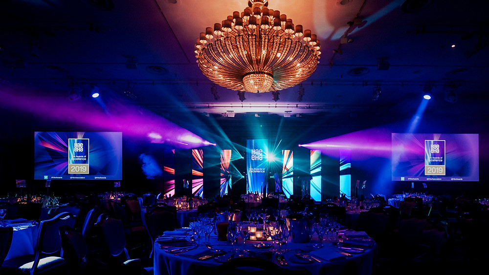 Front on shot of HAE Awards showcasing stage design, lighting, LED walls & screens.