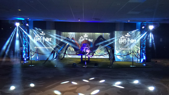 Front on shot of brand experience event showcasing stage design, lighting & event theming.