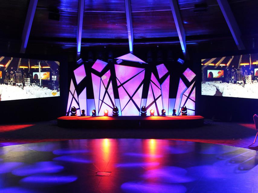 Front on shot of Gatwick Diamond Business Awards showcasing stage design, lighting & screens.