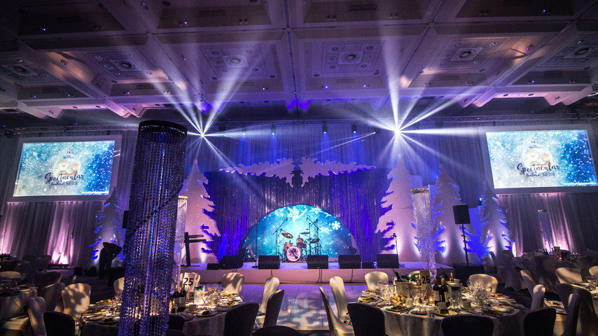 Front on shot of Snowman Spectacular Ball showcasing stage design, lighting, sound systems & screens.