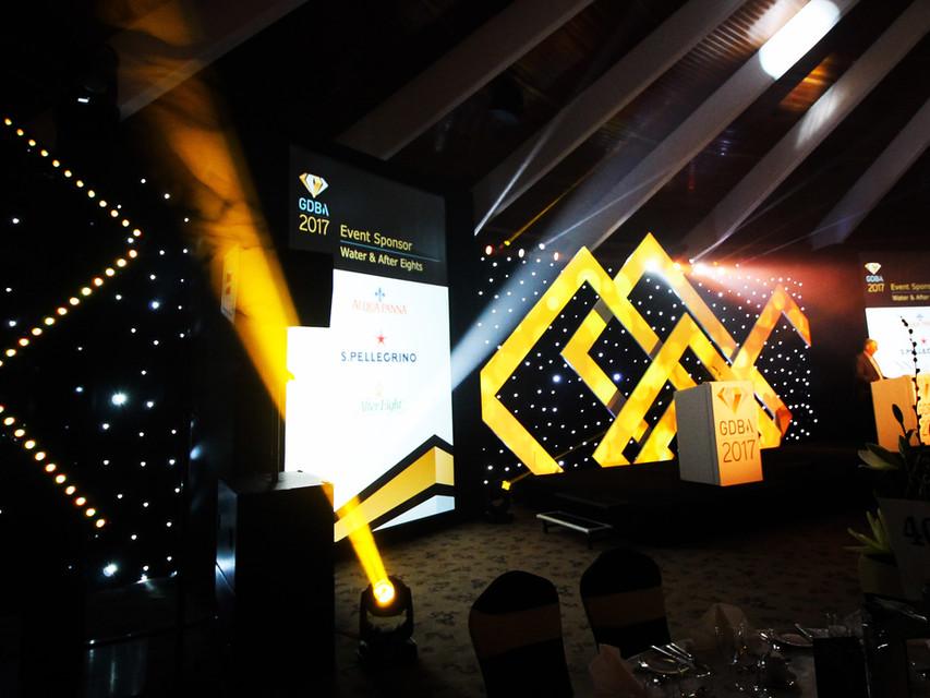 Angled shot of Gatwick Diamond Business Awards showcasing stage design, lighting, LED walls & event theming.