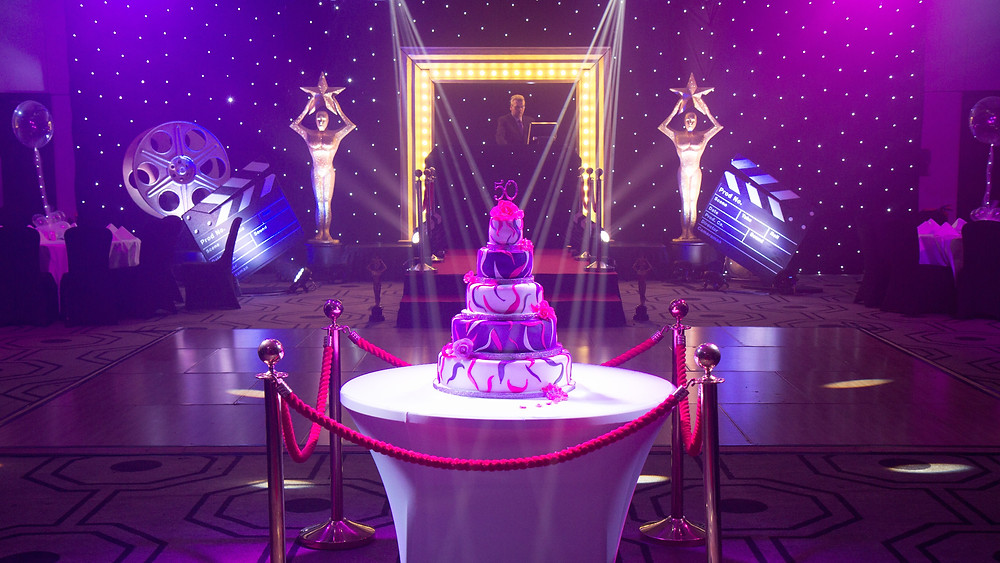 Front on shot of 50th Party - Hilton showcasing set design, lighting & LED walls.