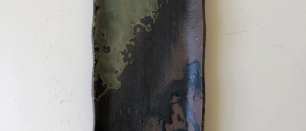 rectangular, ceramic dish with abstract design