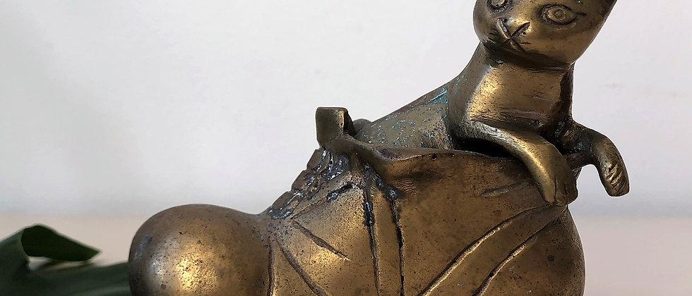 brass cat in a shoe
