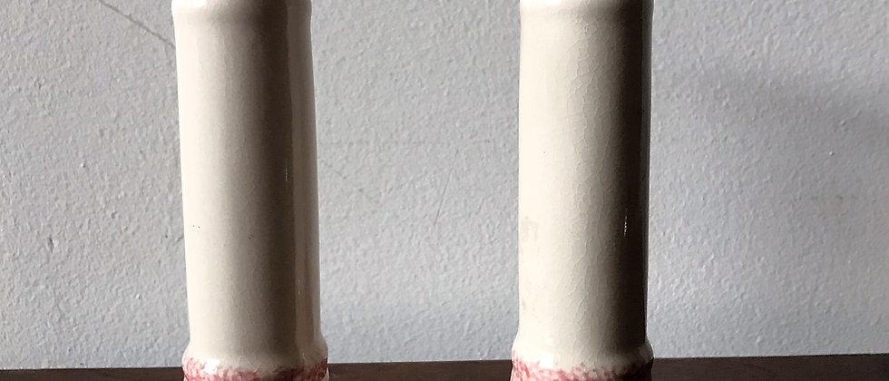 pair of cream and pink, ceramic candlesticks