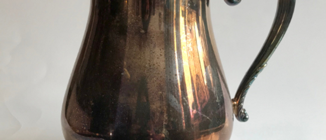 silver plated, oneida pitcher, with patina