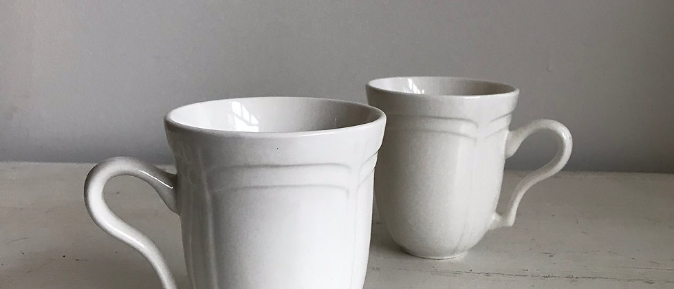 pair of white, ceramic gibson mugs