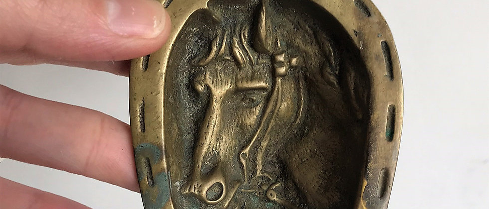 brass, horseshoe shaped ashtray