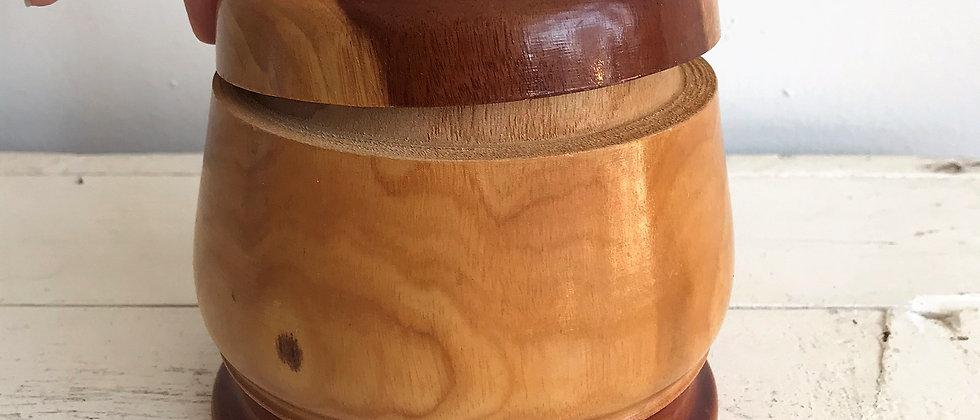handcarved, wooden canister