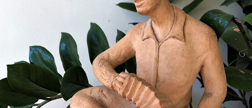 ceramic statue of man, playing accordion