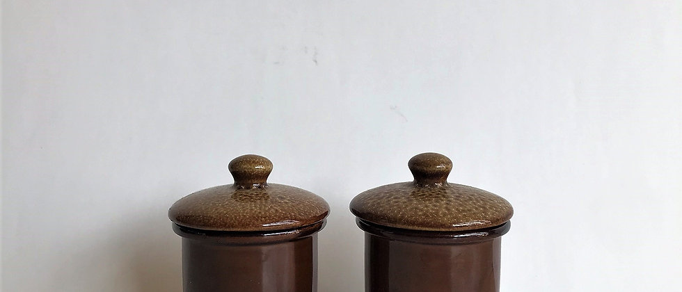 pair of small, ceramic canisters