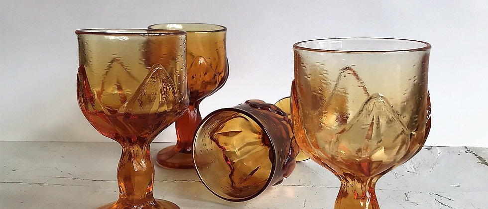 set of four, amber colored goblets
