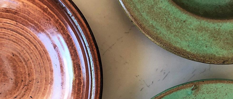 trio of small, ceramic dishes
