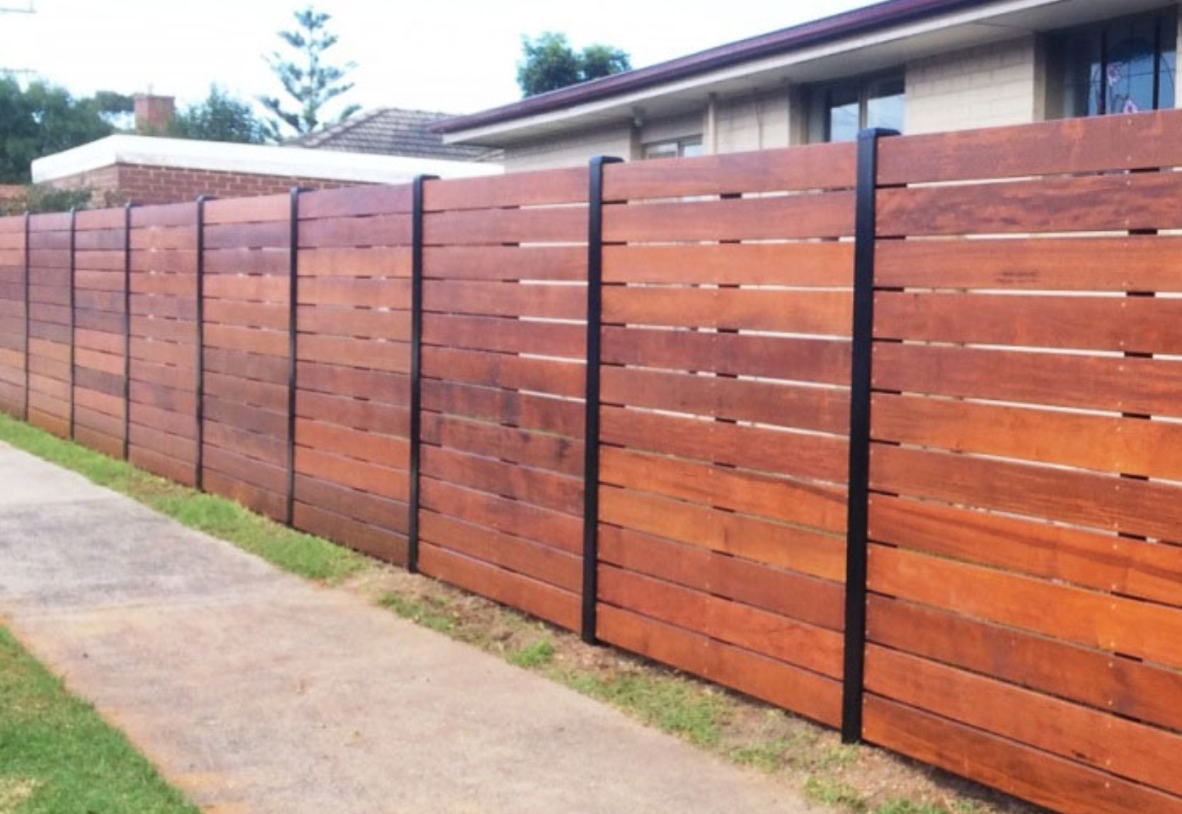 Stained Merbau Slat Fence