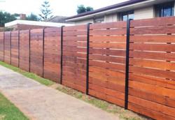 Stained Merbau Slat Fence