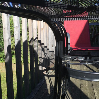 Red chair on the deck