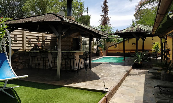 Pool, garden, seating area, grill, braai