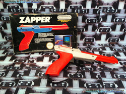 www.nintendo-collection.com - NES Zapper Orange