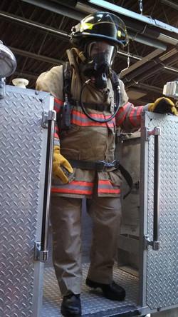 EMS fellow in bunker gear