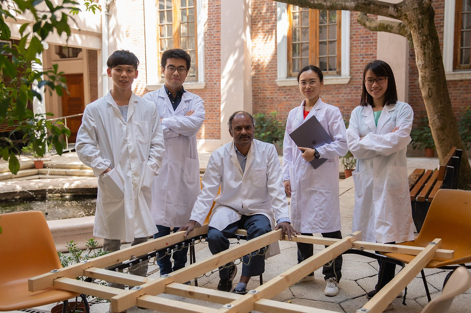 Rajan with oyster raft students.jpg