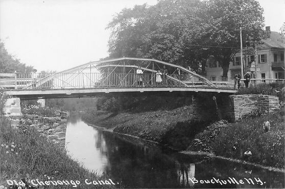 Whipple Bridge with people on bankc 1920