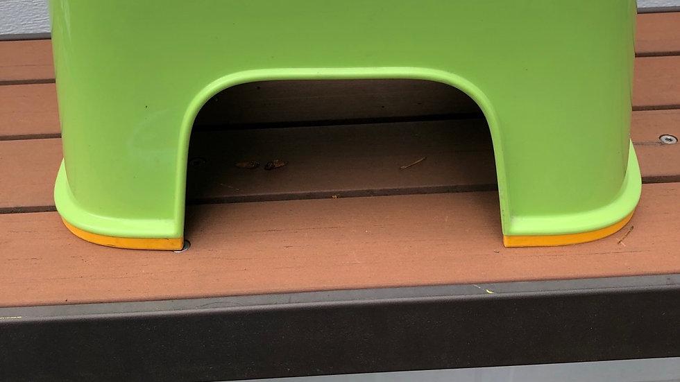 Green and yellow baby bjorn stepstool