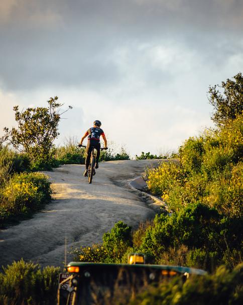 Mountain Biker Climbing
