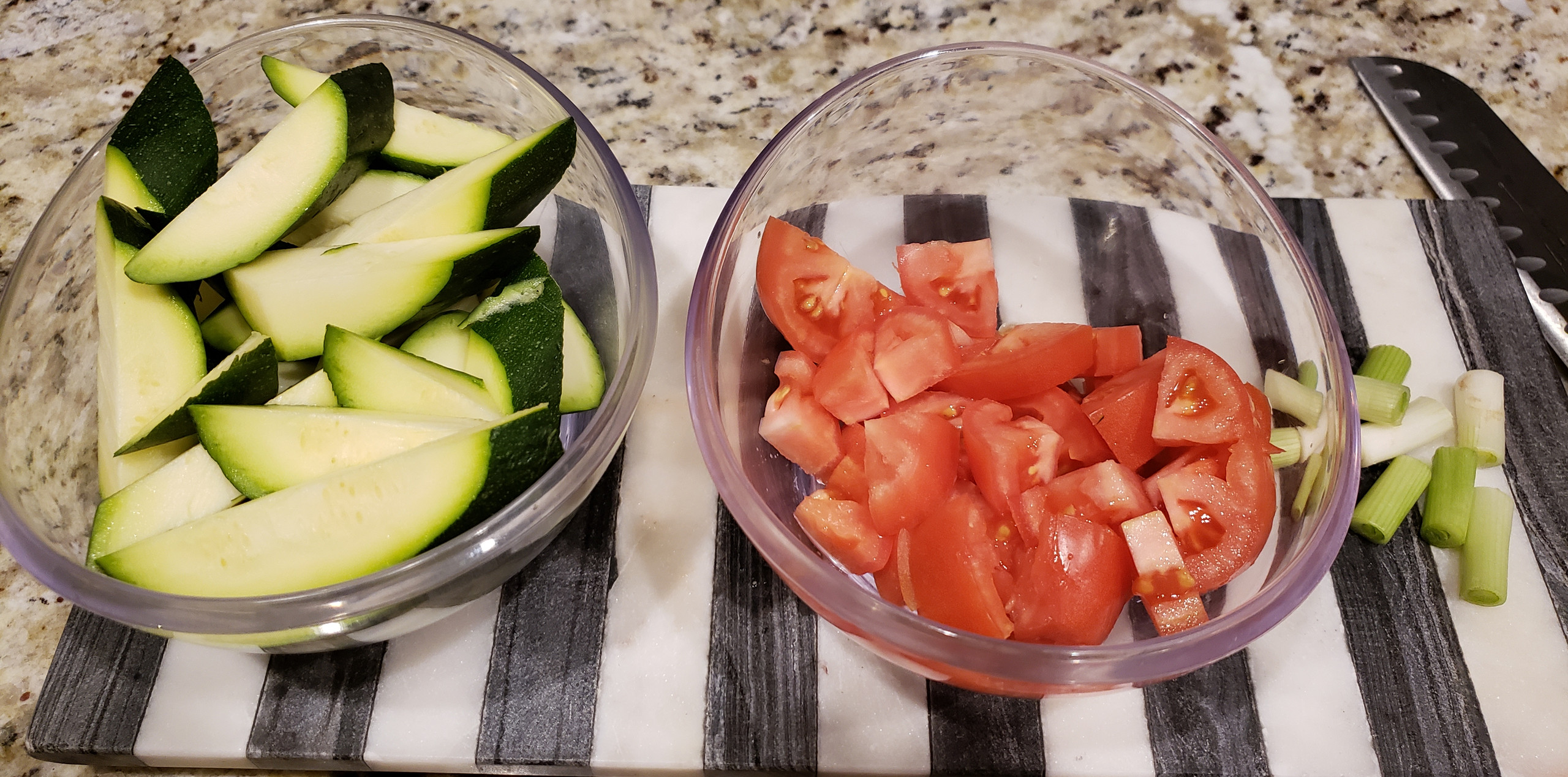 Prepping my zucchini and tomatoes before sauteing them.
