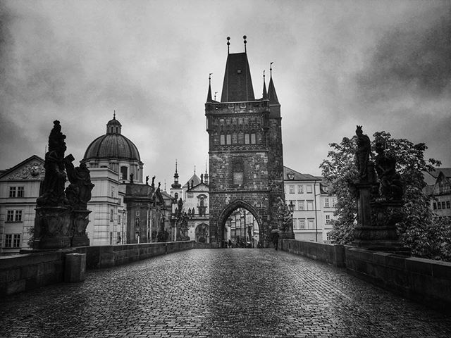 The Charles Bridge is a famous historic bridge that crosses the Vltava river in Prague, Czech Republ