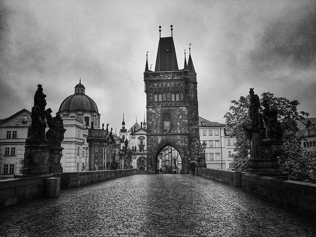 The Charles Bridge is a famous historic bridge that crosses the Vltava river in Prague, Czech Republ