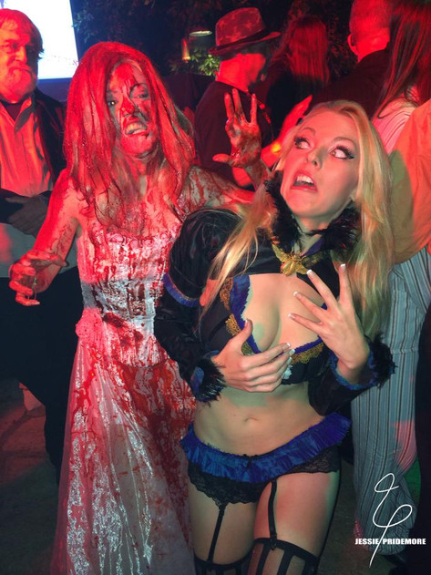 Jessie performing at the Playboy Mansion Halloween party as Carrie