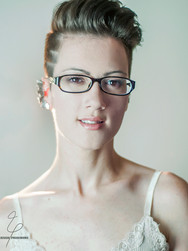 jessie pridemore headshot brunette pixie glasses.jpg
