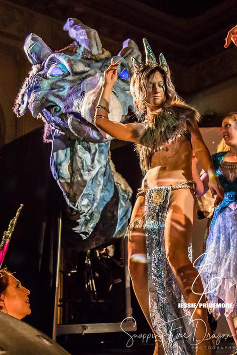 Jessie on stage performing at the Labyrinth Masquerade Ball  Photo by Snapping Dragon Photography