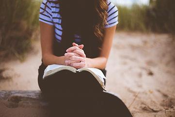 woman legs_hands crossed w_Bible.jpg