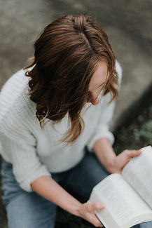 woman on the floor with open Bible.jpg