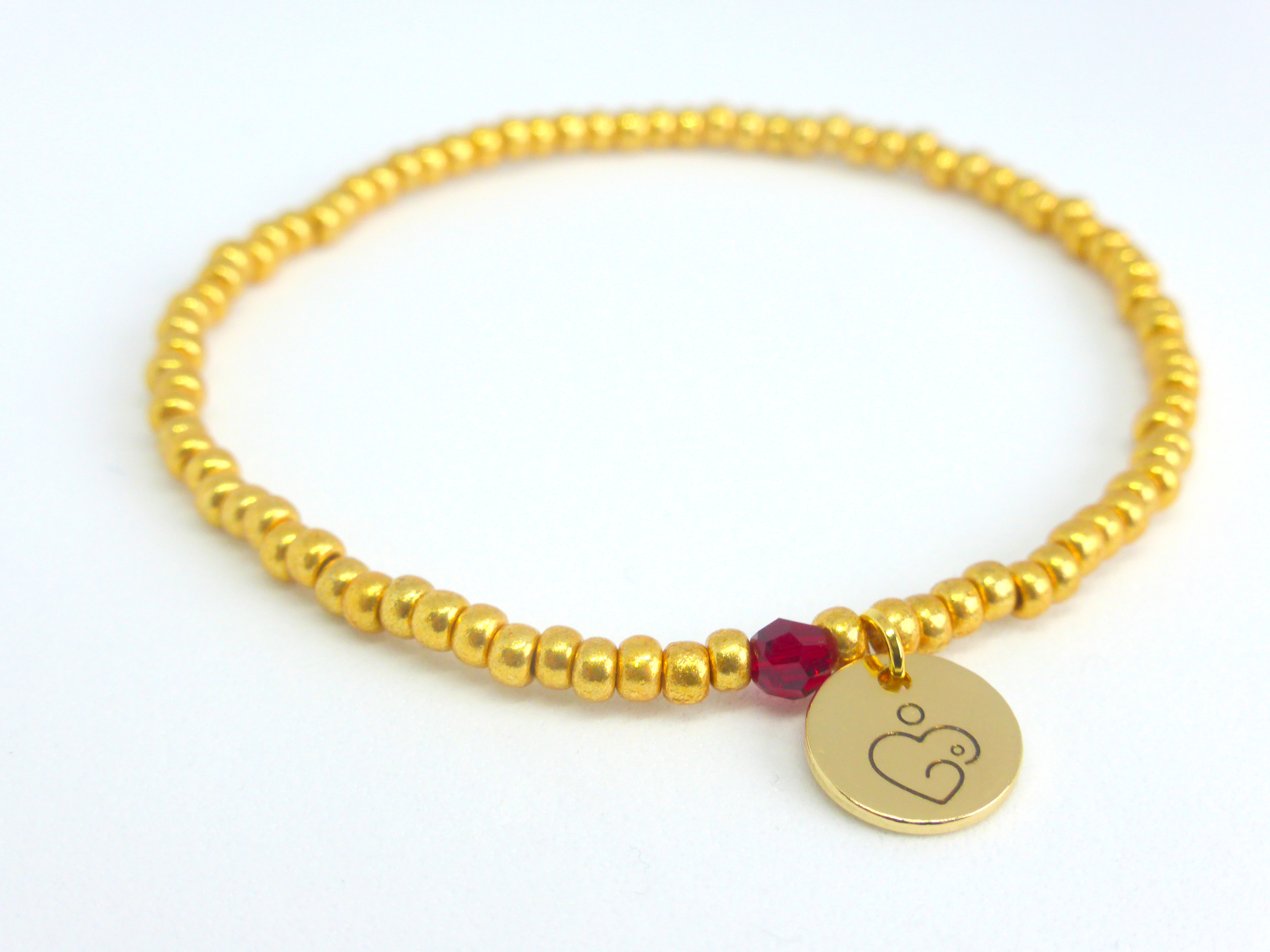 Golden Boobies with Ruby birthstone