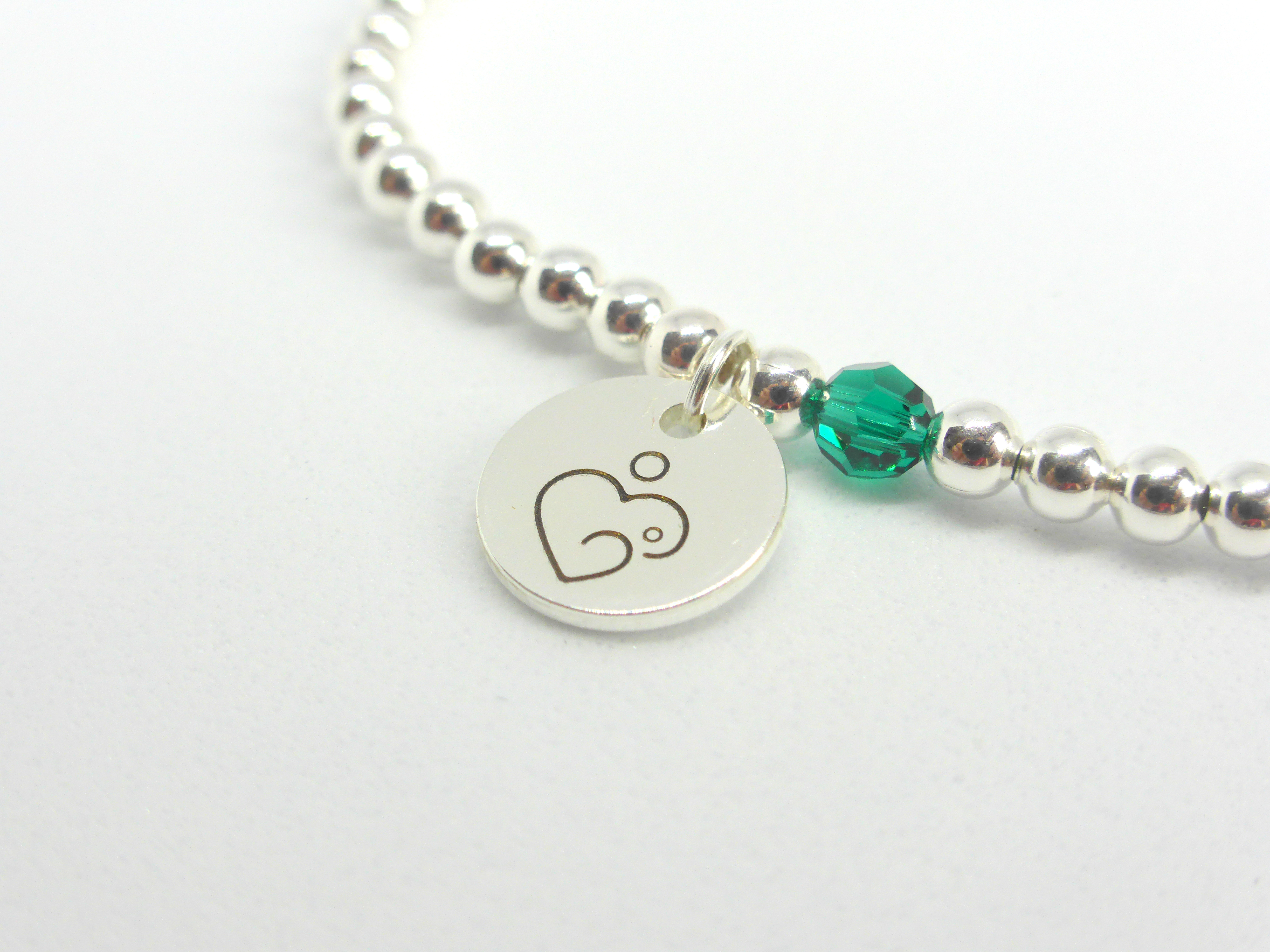 Silver bracelet with Emerald