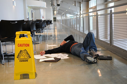 Man lies on the wet floor on which he sl