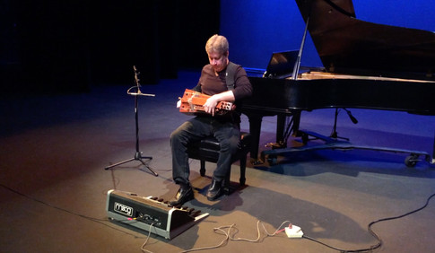 Eric Klein performing on hurdy gurdy and Taurus Pedals