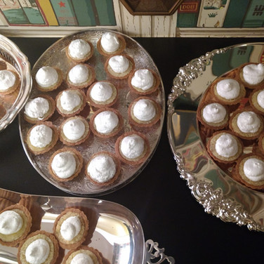 Miniature key lime and lemon cream pies with whipped cream