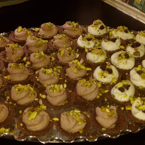 Chocolate and vanilla ricotta filled Chocolate cups with crumbled pistachios
