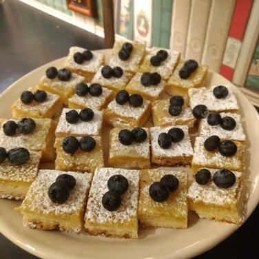 Lemon bars squares with fresh berries