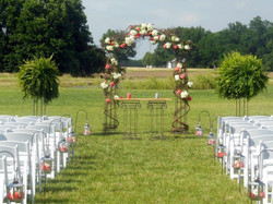 iron arch with plant stands and unity table.jpg