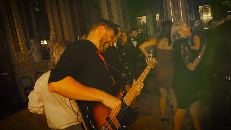 Bassist dancing with guests